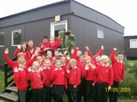 Here we are outside our classroom with our giant sunflower.  Was there a prize Mr. McCarthey? - click for full size image